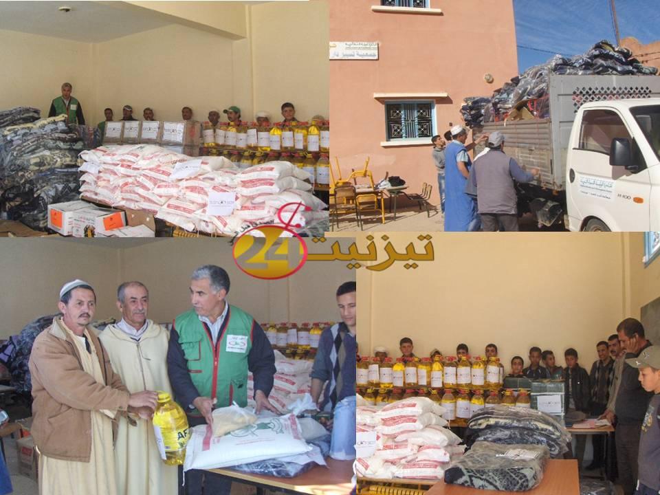 تقرير حول توزيع مواد غذائية وأغطية على المتضررين من الفيضانات بجماعة أيت أحمد