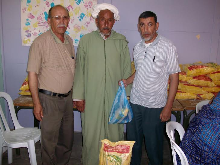 حول عملية توزيع المساعدات الاجتماعية بمدرسة الحسن الاول واعدادية الامام مالك